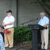 Chapter member Jim Brown ( R ) addressing the audience and chapter member Dan Imire with Flowers for the ceremony